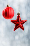 Red Xmas decorations on silver bokeh background. Merry Christmas and Happy New Year Stock Photos