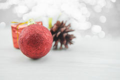 Red xmas ornaments with pinecone on wood floor. Merry Christmas and Happy New Year. Royalty Free Stock Images