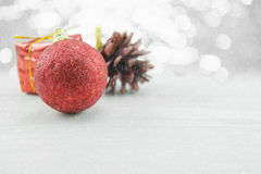 Red xmas ornaments with pinecone on wood floor. Merry Christmas and Happy New Year. Stock Images