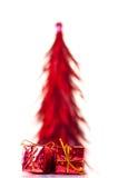 Red xmas tree with presents Stock Photos