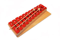 Red xylophone. A red xylophone instrument isolated against a white background Stock Image