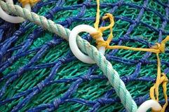Red y anillos de pesca Fotos de archivo libres de regalías