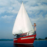 Red yacht. Girl staying on yacht and going into the sea Stock Images