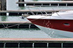 Red yacht in harbor Royalty Free Stock Images