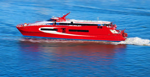 Red yacht with motion blur Stock Image