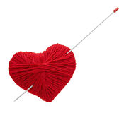 Red yarn heart with spoke, isolated on white Royalty Free Stock Image