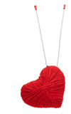 Red yarn heart with spokes, isolated on white Royalty Free Stock Photo