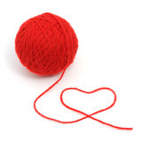 Red yarn with heart symbol royalty free stock images