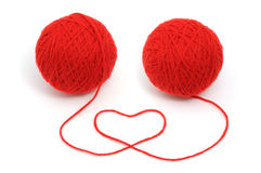 Red yarn with heart symbol Stock Photography