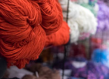 Red yarn in retail display Stock Photo