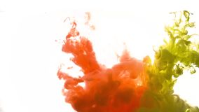 Red and yellow acrylic paint or ink splashing underwater stock video footage