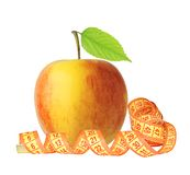 Red and yellow apple fruit with green leaf and measure tape Stock Image