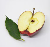 Red yellow apple with green. Leaf and slice isolated on white background Stock Image