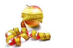 Red-yellow Apple with a measuring tape Stock Image