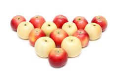 Red and yellow apple put by triangle Stock Photos