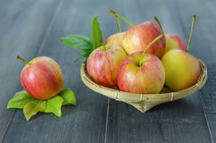 Red and yellow apple   on wooden background Royalty Free Stock Photo