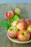 Red and yellow apple   on wooden background Royalty Free Stock Photography