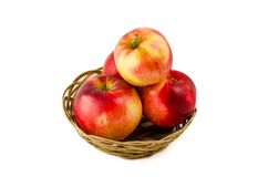 Red and yellow apples in the basket Royalty Free Stock Photo