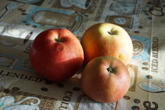 Red and yellow apples on a colored tablecloth Stock Photo