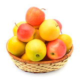 Red and yellow apples in a wicker basket Royalty Free Stock Photography