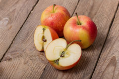Red yellow apples on a wooden background Royalty Free Stock Images