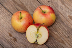 Red yellow apples on a wooden background Stock Image