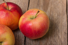 Red yellow apples on a wooden background Royalty Free Stock Photography