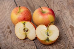 Red yellow apples on a wooden background Royalty Free Stock Photos