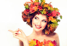 Red and yellow autumn Leaves on girl head. Royalty Free Stock Photography
