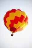 Red & Yellow ballon on the sky. Stock Photos
