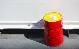 Red and Yellow Barrel by White Wall Stock Photos
