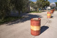 Red and yellow barrels on the Street Royalty Free Stock Photography