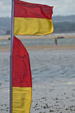 Red & Yellow bathing flags Stock Photography