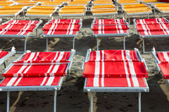 Red and yellow beach chairs Royalty Free Stock Photography