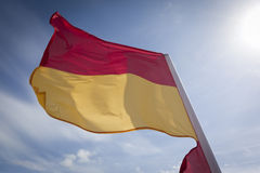 Red and Yellow Beach Safety Flag Stock Photo