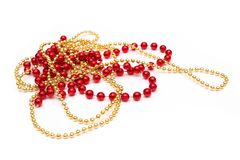 Red and yellow beads isolated on a white background. Royalty Free Stock Image