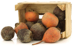 Red and yellow beets in a wooden crate Stock Images