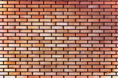 Red yellow beige tan fine brick wall texture background, large detailed horizontal closeup Stock Photo