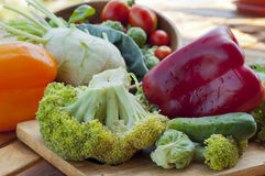 Red and yellow bell pepper, cauliflower, cucumber with broccoli Royalty Free Stock Image
