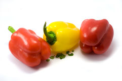 Red and yellow bell peppers. Whole red and yellow bell peppers isolated on white background Royalty Free Stock Photography