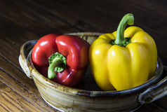 Red and Yellow Bell Peppers. In a dish Stock Photos
