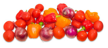 Red and yellow bell peppers, tomatoes and red onions closeup Stock Photos