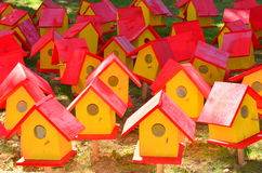 Red and yellow bird houses