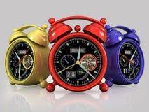 Red yellow blue alarm clocks Royalty Free Stock Photo