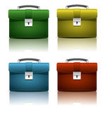 Brief cases. Red, yellow and blue brief cases in vector. EPS10 vector illustration