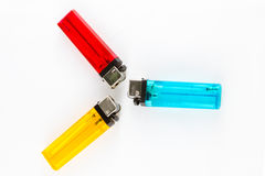 Red, yellow and blue cigarette lighters. Stock Images