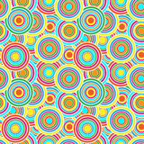 Red, yellow and blue circles seamless vector pattern. Stained glass circles mosaic red, green, yellow and orange colors on blue background vector illustration