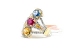 Red, yellow and blue Diamond with white diamond and gold ring Stock Photography