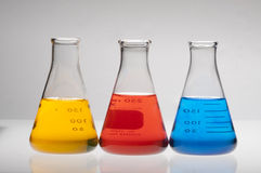 Red, yellow and blue Ehrlenmeyer flasks Royalty Free Stock Image