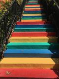 Red yellow blue and green painted multicolors steps. Red yellow blue and green painted  outdoor multicolors steps with black barrier Royalty Free Stock Photos